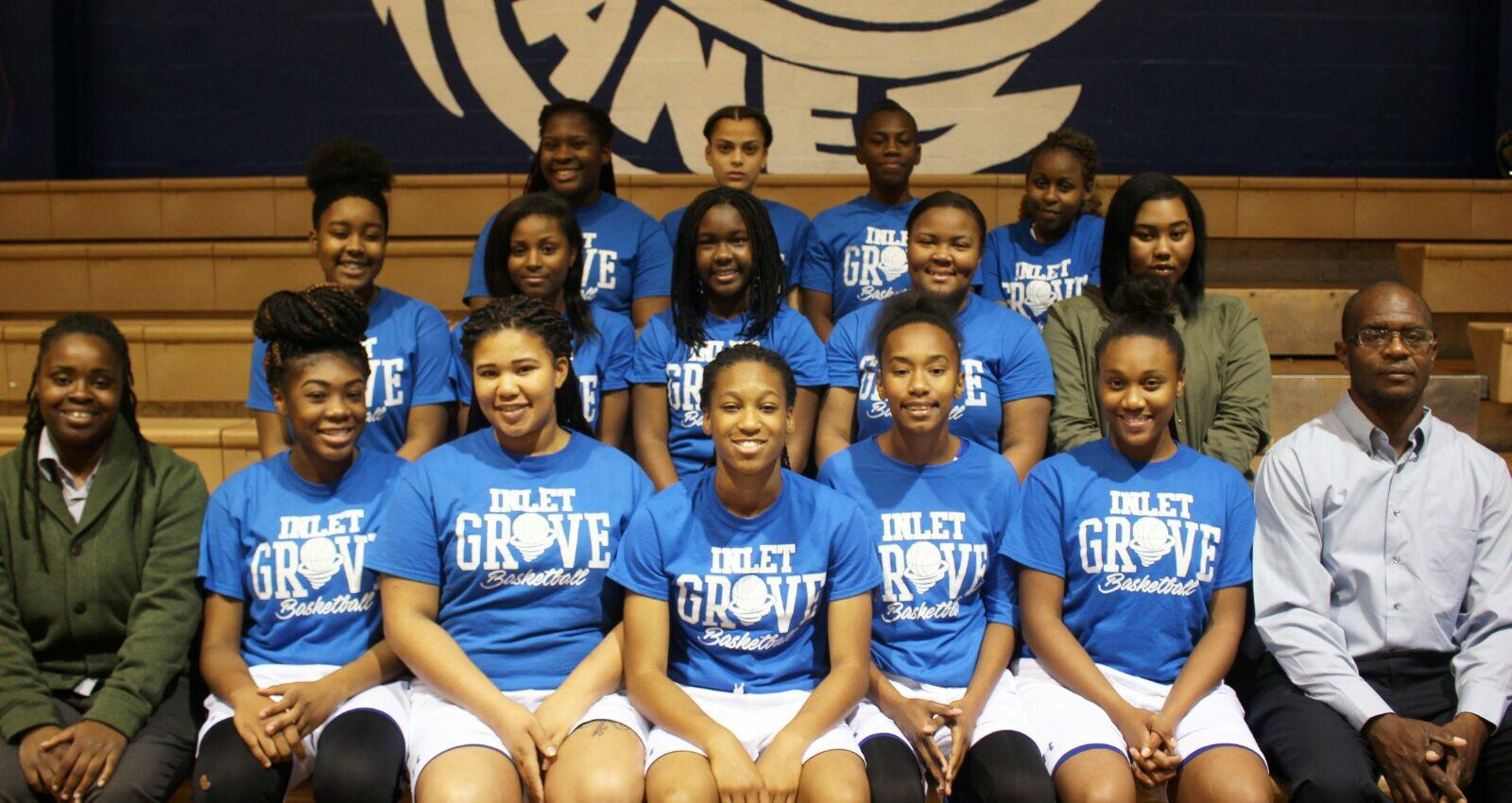 LADY CANES FAMILY: Reminiscing on their season are the ballers of 2016-2017: (from front left) Coach Sasha Barnard, Jessica Dominique, Janae Brewer, Jasmine Simmonds, Toni Andrews, Nehani Abreu, Coach Darrin Kelly; (2nd row): Tatyana Moise, Kathleen Morvan, Carlteria Phillips, Flolaine Francois, Yolanda Gena; (3rd row): Chanique Coleman, Jennifer Parisot, Briana Cason, Briana Bolivar.