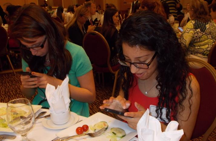 Too distracted to eat? GroveWatch Photo Editor Makeighla Claunch (left) and Editor-in-Chief Angie Garcia during the High School Journalism Awards Luncheon, April 30, where from start to finish everyone was Instagraming.
