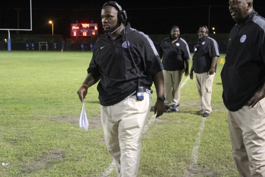 PREPARATION AND HARD WORK: Athletic Director and Head Football Coach Terry Bradden and his staff, whose efforts resulted in an inspiring season-opening win.
