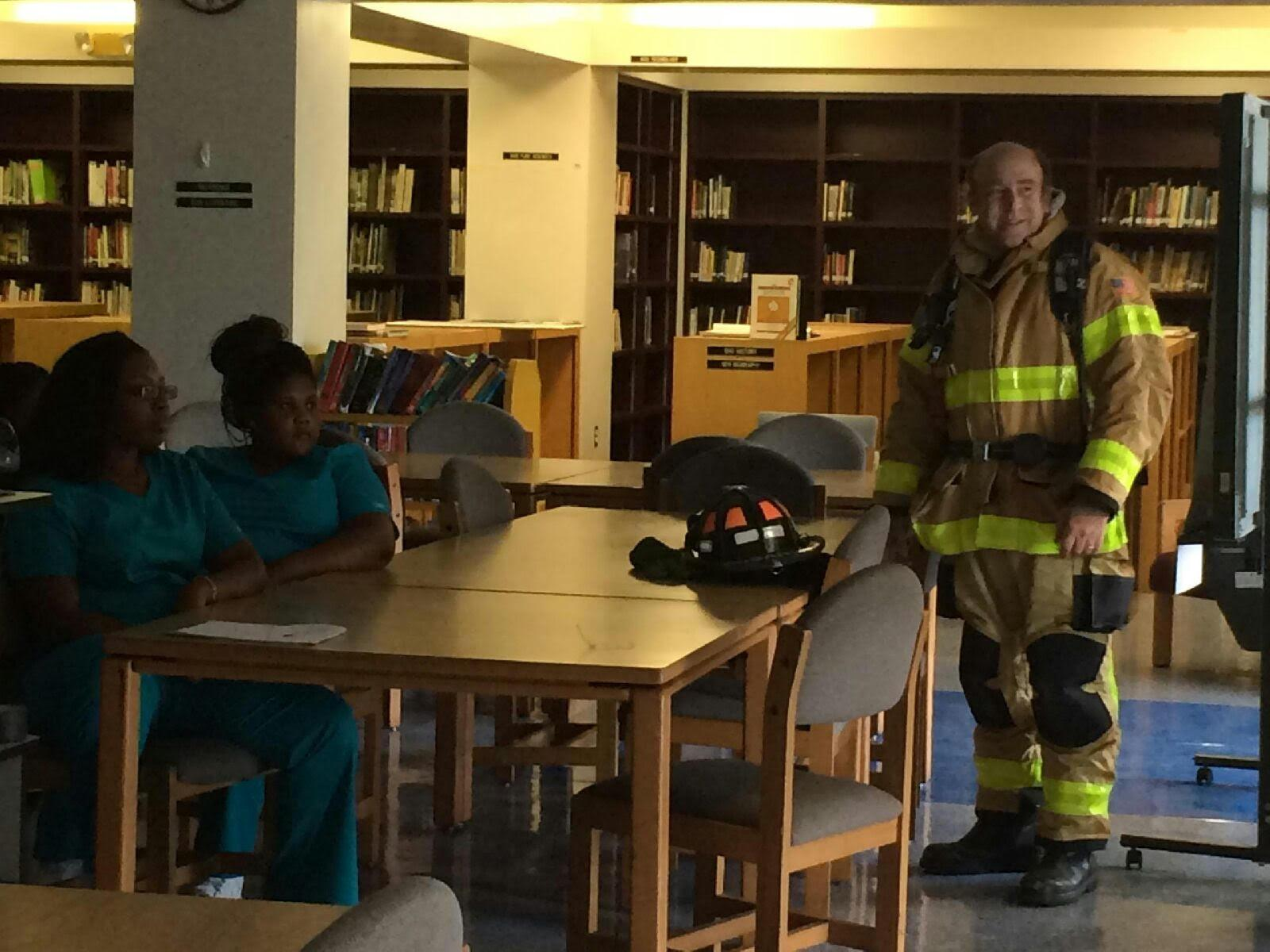 """REAL-WORLD SCENARIO: Students enjoyed a simulated emergency scene in the Media Center with Palm Beach County Fire Rescue Capt. Craig Pruzansky. """"It was really interesting,"""" said Jasmine Felix, a junior  in the Medical Academy. """"It was the best educational experience yet."""""""