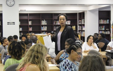 PARENT NIGHT: Compliance Manager, Juanita  Edwards discusses the School Wide Progress Monitoring Plan during the  Oct. 15 Title I Parent Night Meeting in the Media Center that preceded the Open House.