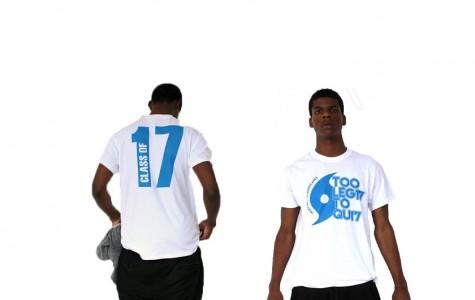 TOO LEGIT: Taylen Barr, a junior in the Web Design Academy, models the latest junior shirts.