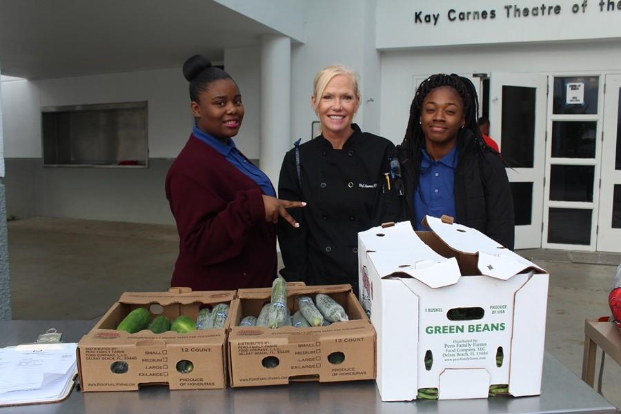GOING GREEN: Chef  Tammy Newman and some of her Culinary students gave fresh cucumbers and green beans to families for the Thanksgiving holiday.