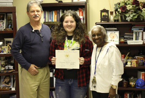 WHITE HOUSE HONORS: Shanon Steinmetz (center) is congratulated by Principal Emma Banks and Assistant Principal Jack Myskowski on receiving the President