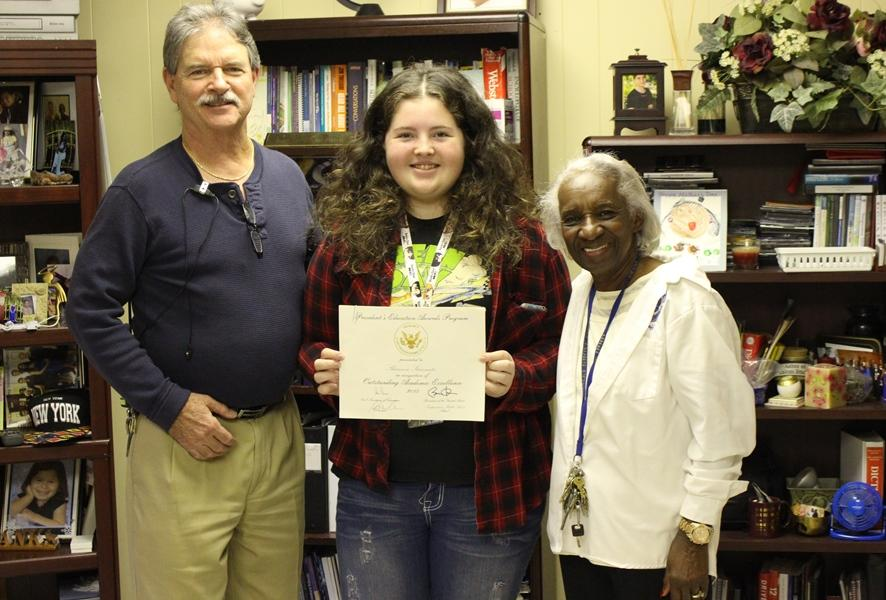 WHITE HOUSE HONORS: Shanon Steinmetz (center) is congratulated by Principal Emma Banks and Assistant Principal Jack Myskowski on receiving the President's Education Award.