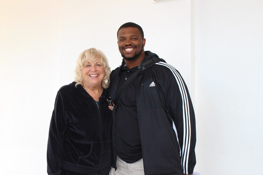 ACADEMICS MEET ATHLETICS: Margaret Bell, left, and Coach Terry Bradden Jr. pause after their busy day to take a picture.