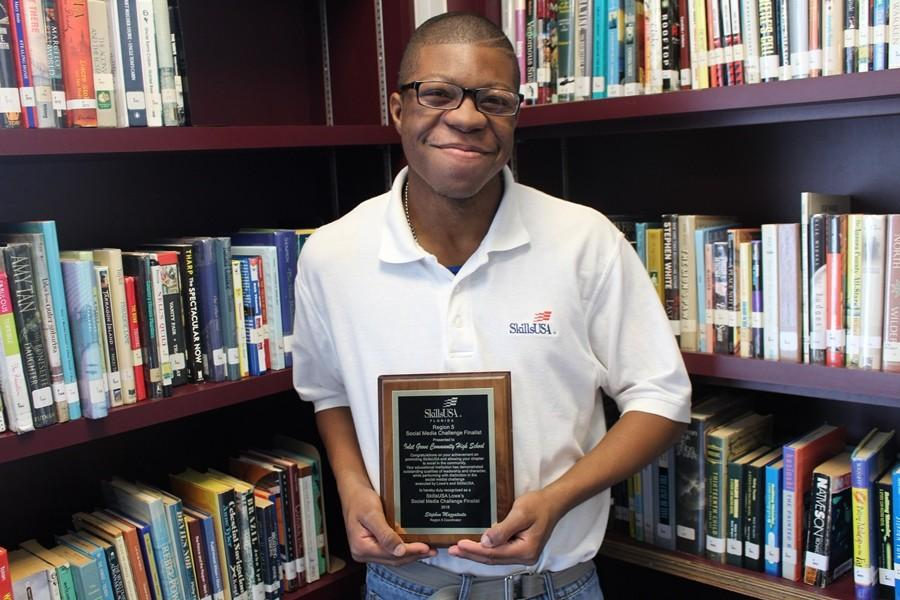 BOP TO THE TOP: Derico Jones proudly displays Inlet Grove's Social Media Challenge Award received last Wednesday during a special ceremony. Rakim Williams, Terence Graham, Jenny Ferdelus, Nondiana Emmanuel and Derico Jones were among students who produced a rap video and social media calendar for SkillsUSA. Inlet Grove was the only school in Florida to be named a national finalist, and one in only five high schools in the nation to move on to the final round of the competition. Help them win the $25,000 Grand Prize to fight teen obesity through likes, shares and comments: https://www.youtube.com/watch?v=QqA5Q-U0Pig