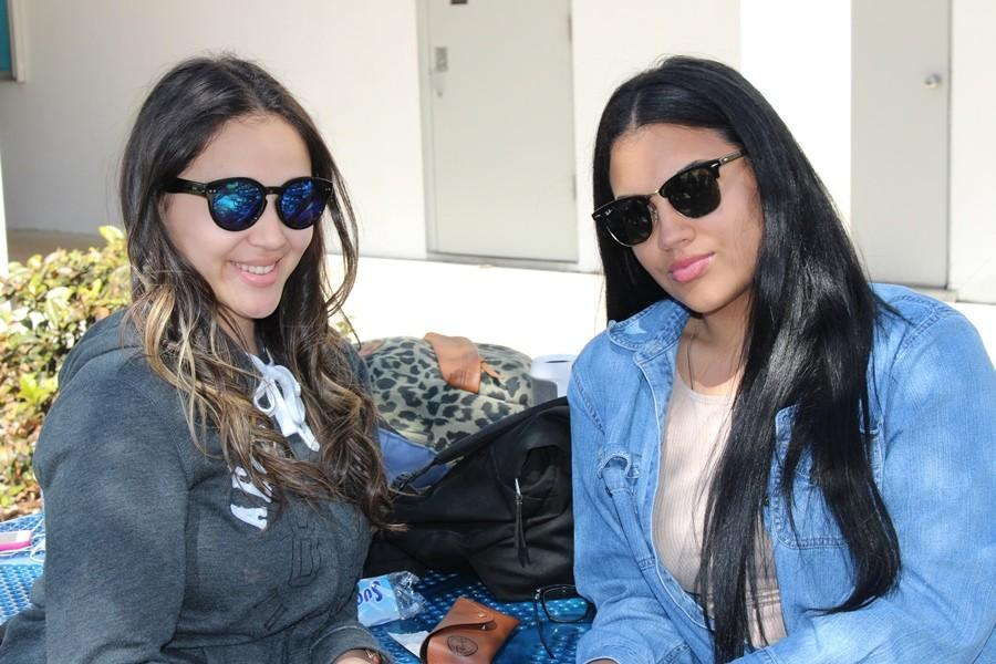 WHEN IN DOUBT, SHADES OUT: Natalie Hernandez,left, and Daisy Quiroga chilling under the Florida sun.