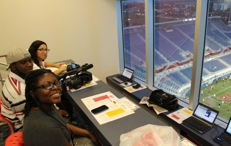 TOUCHING DOWN:  At the Boca Bowl football game at Florida Atlantic University Multimedia Academy students Terence Graham, Shirley Pierre and Angie Garcia hung out in the press box covering the game.