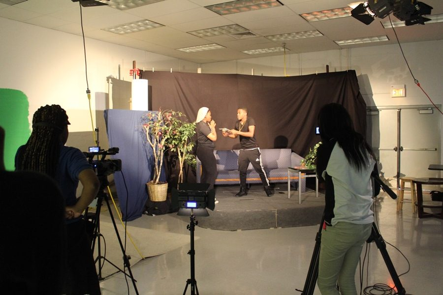 Kiara Smith (as Gina Payne) and Deandre Somerville (as Martin) recreate a scene from Season 2 of the sitcom.