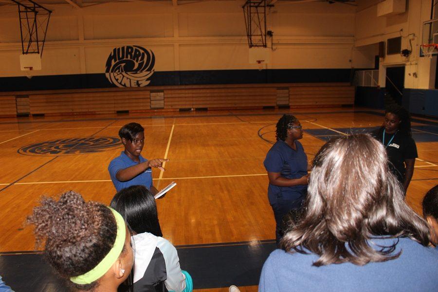 FORMER: Varsity Basketball team member , Carlteria Phillips  introduces herself .