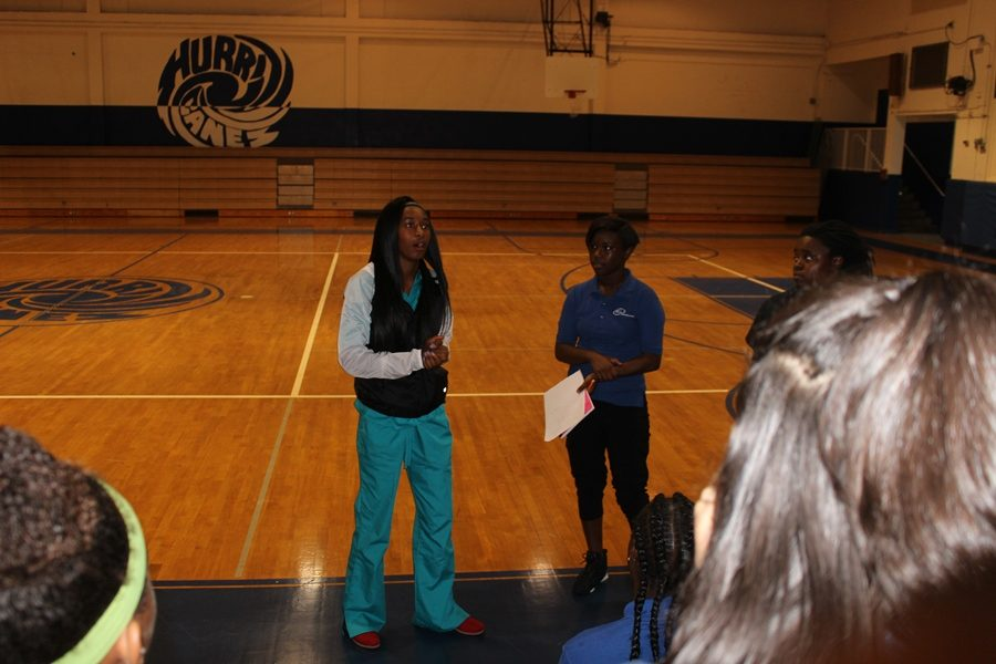 TEAMATES: The former Varsity  basket ball Captain,  Toni Andrews speaks to some under and upper classman about joining the team .