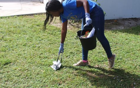 NEAT AND TIDY: Tanoy Thames and her fellow National Honor Society  members continued their campus cleanup project during lunchtime Oct 17. Tanoy, a junior in the Medical Academy, is also the Junior Class president and the student representative on the School Advisory Council.