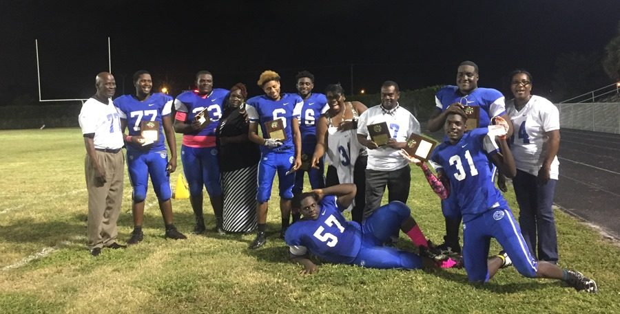 SENIOR+NIGHT%3A+The+Canes+football+team+put+effort+into+the+last+home+game+of+the+season+against+Pembrook+Pines+Christian.+The+Canes+fought+hard+with+the+final+score+being+42-8.+Parents+and+senior+football+players+join+together+as+they+receive+their+awards.