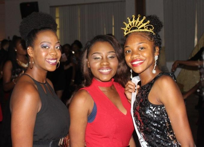 SENIORS NIGHT: The atmosphere was filled with excitement and happiness, and the DJ played many varieties of music for different cultures and styles, as members of the Class of 2017 including, (from left) Taylor Douglas, Mildred Augustin and Donasia Wilson, Homecoming Queen, enjoyed their last Homecoming Dance, Oct. 29 in the cafeteria. Student Government Association adviser Ms. Morrison worked tirelessly to organize the event and throughout the night, while other staff members served food and served as chaperones.