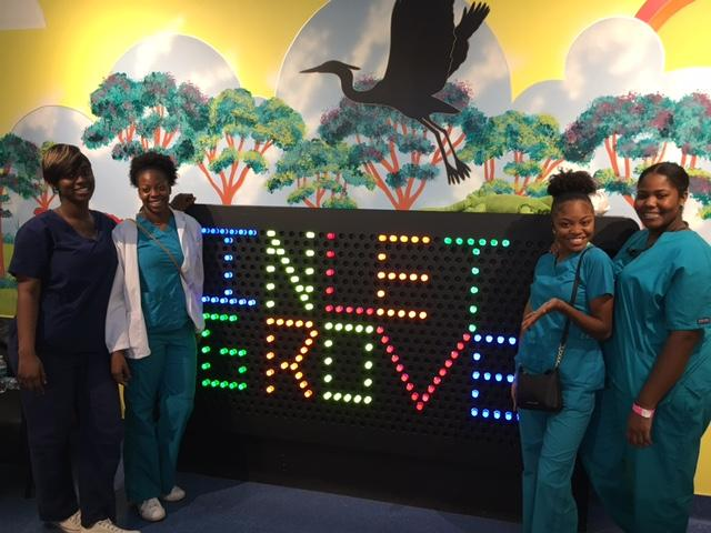 ANATOMY AND PHYSIOLOGY: Medical Academy students (from left) Karen Douglas, Taylor Douglas, Donasia Wilson and Aiyanna Brown learned more about it during a visit to the South Florida Science Center and Aquarium, Nov. 16.