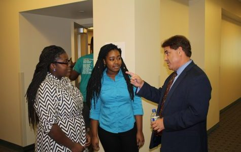RICK SANCHEZ: Brianna Luberisse, left, and Tatyana Moise talk with the television correspondent and news anchor of more than 30 years after his session on