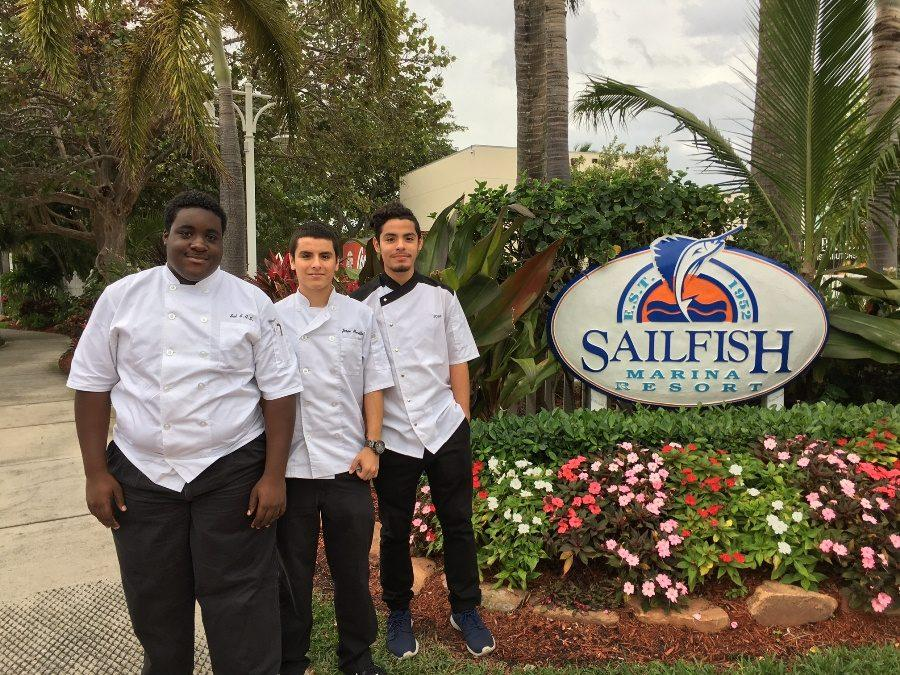 GETTING CREDIT: Canes including, from left, Sal Sargent, Jorge Murillo, and Jose Murillo are interning at Sailfish Marina for Culinary hours.