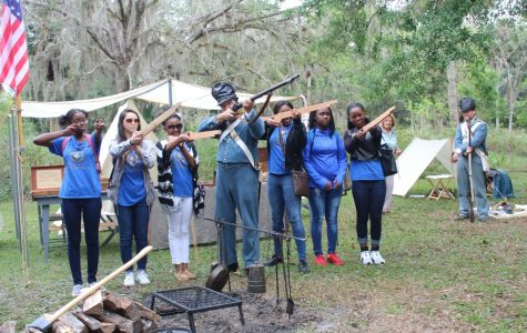 LEARNING ABOUT THE PAST: At Riverbend Park in Jupiter during the Jan. 27 re-enactment of the Battle of Loxahatchee, the Canes were there -- specifically, members of the National Honor Society.