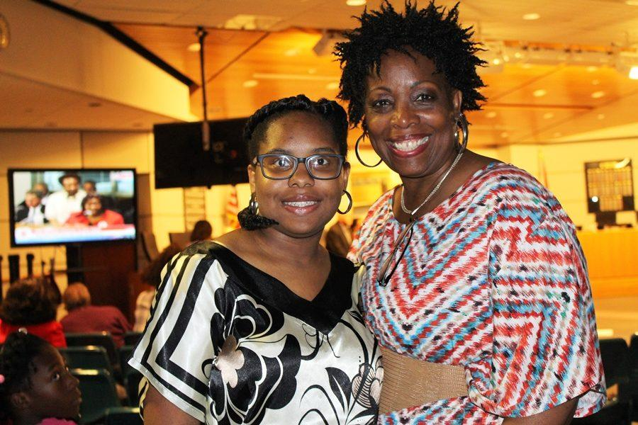 """VICTORY FOR UNITY: Cane-gratulations to sophomore Victoria Lawrence (left), daughter of Herman and Judith Lawrence, shown here with her mother, president of Inlet Grove's School Advisory Council, as Palm Beach School Board members honored dozens of winners of the 2017 Martin Luther King, Jr. Scholarship Contest during the Feb. 15 board meeting. Victoria won second place in this year's MLK Oratorical Competition for her presentation on this year's theme, """"Defend the dream united; promote non-violence, social justice and positive behavior."""" Other Hurricane winners (not pictured) were senior Ruchama LaFontant, first place Essay; freshman Starlia Dormeus, second place and Honorable Mention, Photography; and senior Rachelle Rene, Honorable Mention, Essay. Also recognized by the School Board were Executive Director Edith C. Bush and other members of the Martin Luther King, Jr. Coordinating Committee, the annual scholarship awards sponsor."""