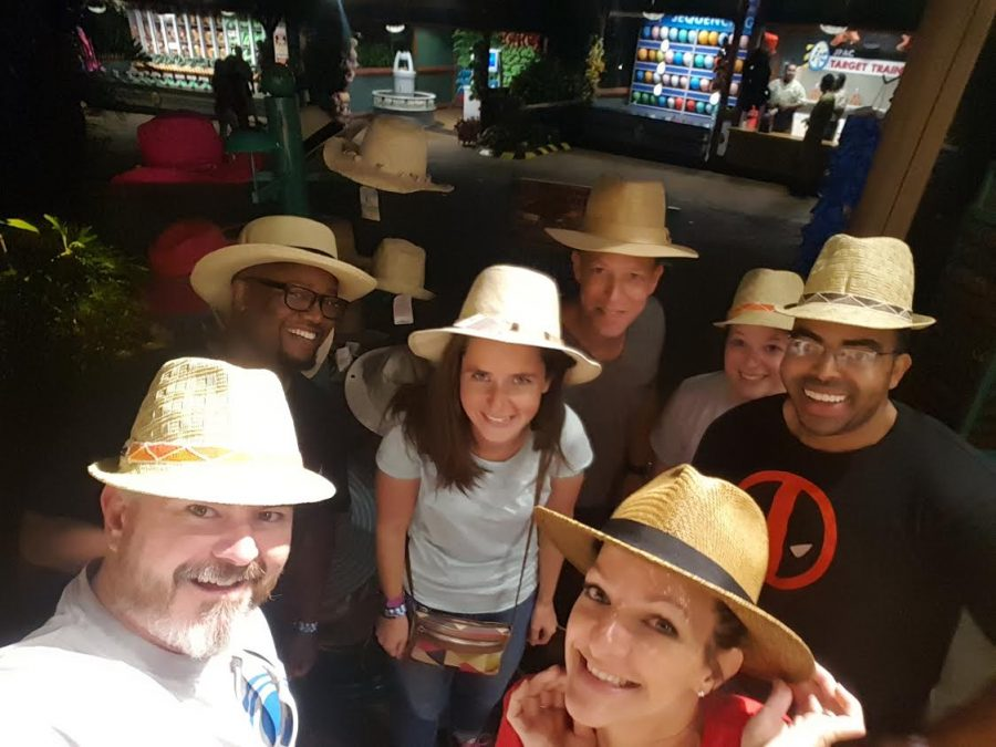 COOL+TEACHERS%3A+The+hats+have+it.+The+Grad+Bash+chaperone+crew+shows+support+for+the+Robotics+team+from+Orlando.+