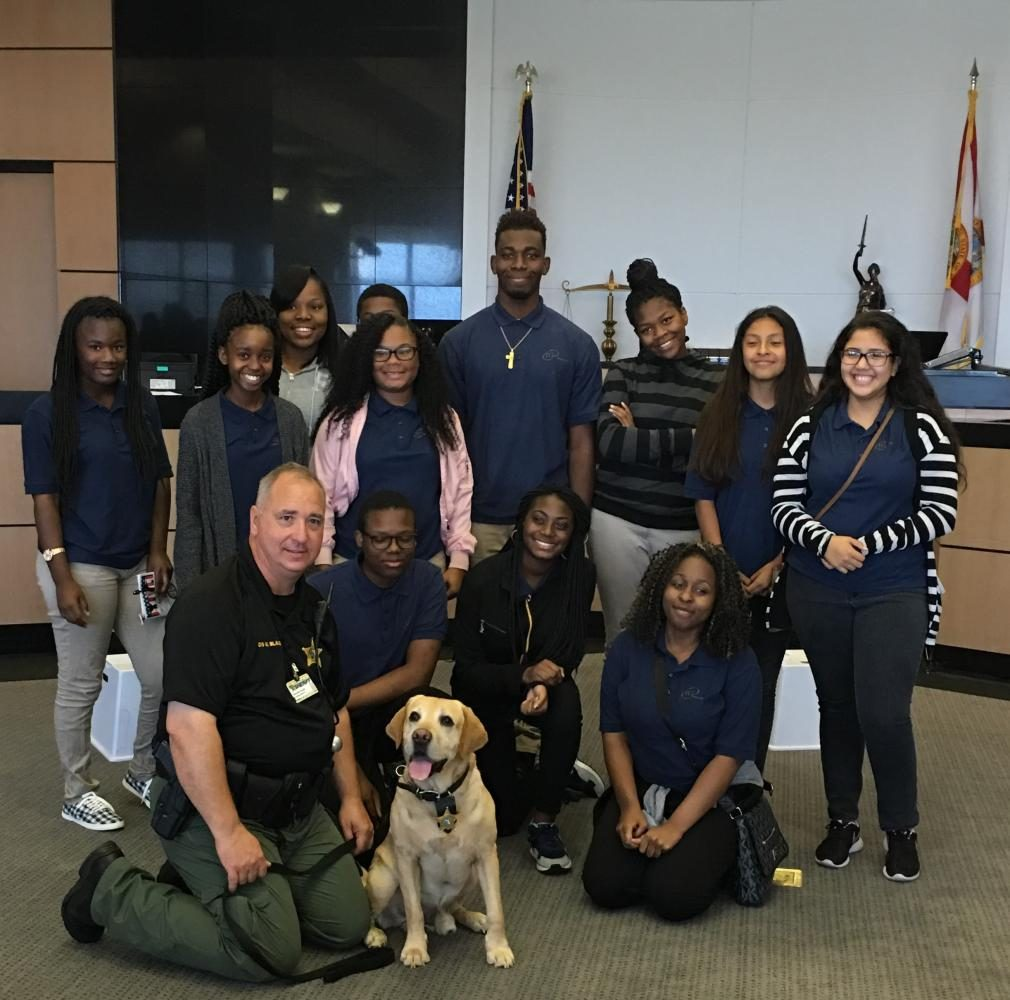 "CLASS ACTION: Pre-Law instructor Dr. Kerkhoff's students experienced meet-and-greets with judges, bailiffs and K-9 dogs, and observed the closing arguments in a criminal trial, May 4 during the ""Law Week"" activities at the Palm Beach County Courthouse."