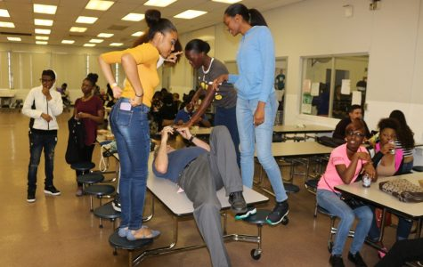 GATHER ROUND: Students take a picture with Principal Jack Myszkowski in the cafeteria to officially kick off summer. Other photos captured the moods of students on the final day of school for 2016-2017.