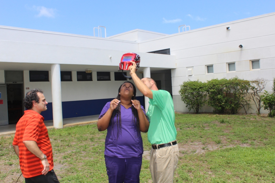 Mr. Rice demonstrates how to view the eclipse through a welding helmet.