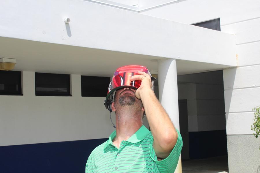 Mr. Rice views the eclipse through a welding helmet.