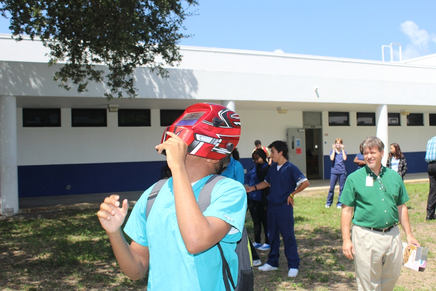 Students and teachers take a break from 4th period classes to watch the eclipse.