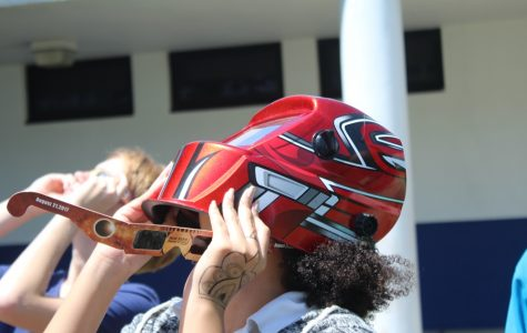 MAJOR EVENT: On the day of the Aug. 2, 2017 solar eclipse, the few students who attended emerged from their quiet, almost empty classrooms to spectate the once-in-a-lifetime event.