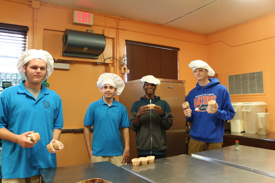 Noah Applbley, from left, Philip Waldbart, Corey Holmes and Steven Beier are new to Chef Newmans Culinary program and proved to be striving by showing what they can do in Chef Newmans Culinary Academy kitchen by learning to make cupcakes and how make them different.