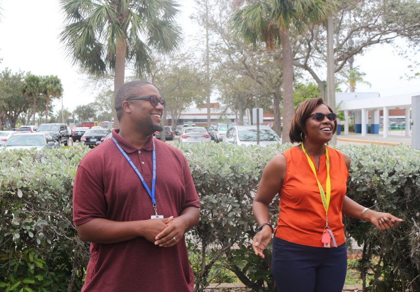 NATIONAL DAY OF PRAYER: Commercial Arts instructor Mr. Bell, left, and History Prof. Maria Morrison united with students and other faculty at the flagpole Sept. 27. The lunchtime gathering was a kickoff for the First Priority club which meets every Thursday during lunch in Room 104.