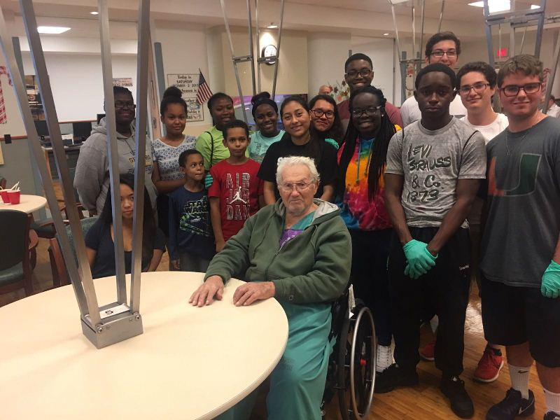 WE'RE HONORED: Key Club members played Bingo with veterans, got to interact with some who fought in World War 2, and celebrated one of the patient's birthdays at the Veterans Administration Hospital in Riviera Beach on Dec. 2.