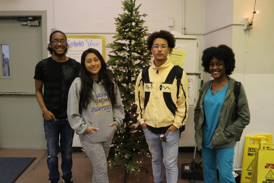 HOLIDAY JOY: The School Improvement Club (S.I.C.) has brought festivity and joy to Inlet Grove. For the first time ever, members made a proposal to uplift school spirit by bringing in the Spirit Tree. In order to get the proposal in action , they had to get it approved by Dr. Banks and their fellow Canes. The Spirit Tree is meant for students to decorate and write positive wishes for the holidays. It is non-denominational and for every student to enjoy. The purpose of the Spirit Tree is tocreate a positive atmosphere. It is a school project for all students to enjoy.