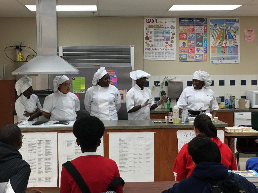 CANES MEET COUGARS : At Congress Middle School Dec. 4, Culinary Academy students taught how to cook fried rice, while Medical Academy students taught cardio-pulminary resuscitation, pulse, and medical safety.