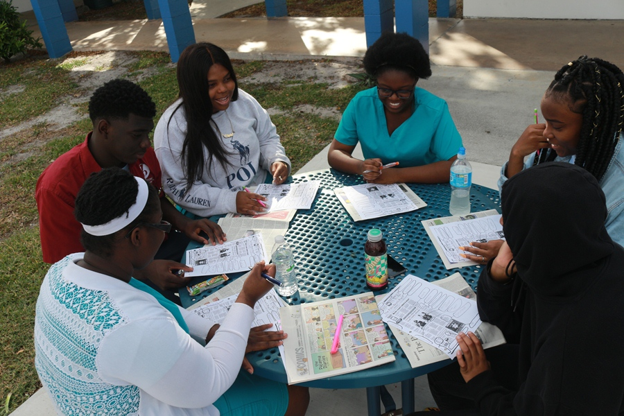 FRESH AIR, FRESH MIND: Students from Mr. Hanif's 2nd hour, take a brief moment to study for their test outside on such a beautiful day.