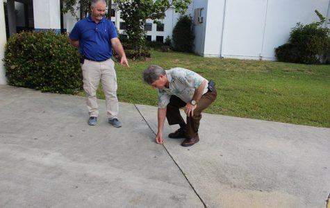 A PENNY FOR YOUR THOUGHT: Mr. Myszkowski and Mr. McDermott at war for loose change.