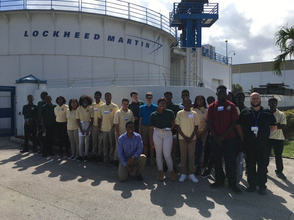ON THE WATERFRONT: Senior Hawonce Luberisse (in red shirt) said his experience going to Lockheed Martin, on a field trip led by Pre-Architecture instructor Mr. Towey, was very interesting, as he learned more about how engineering began and how robotics happens.