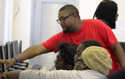 MULTIMEDIA EXPO: Middle school students such as Tavis Riley and Harmony Scott experienced the many elements of the Multimedia Academy, including having their video, photography, design, web and writing work published on the Inlet Grove school website and GroveWatch.com online newspaper.