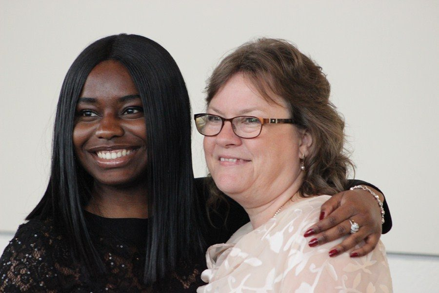 HEROES: Inlet Grove instructors and staff celebrated the 13th annual My Teacher, My Hero Scholarship Awards Gala with their students, fellow educators and supporters from throughout the community at the Palm Beach County Convention Center on May 19. (Above) Sophomore Nhya Elien shows the love for one of her heroes, Assistant Principal Ms. Pientka.