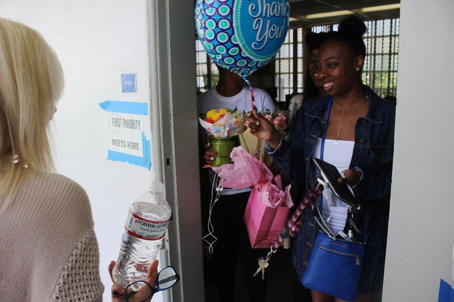 SURPRISE: To show appreciation to Chef Newman for an amazing year a few certified seniors decided to surprise her with cards, flowers, and a balloon before heading off to their celebratory lunch.