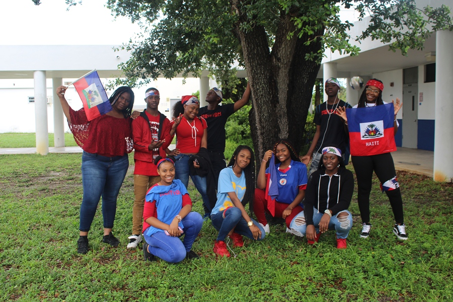 SAK PASE: Haitian Canes gathered together to take a photo in honor of 'Haitian Flag Day'. Today symbolizes the day that the first  Haitian flag was adopted, which was on May 18, 1803.