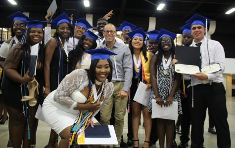 NEW CHAPTERS: As the Hurricanes Class of 2k18 prepared to walk the stage, last time hugs and tears were shared. Mr. Goldstein here is surrounded by some of his accomplished TV & Film Production students following the graduation ceremony held May 21 at the South Florida Fairgrounds.