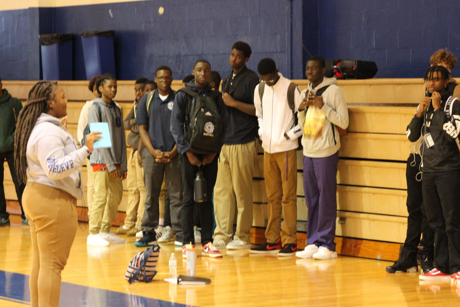 LISTEN UP: During lunch, students came together in the gym to get information about the upcoming basketball season from the head manager, Flo Francois, Aug. 21.