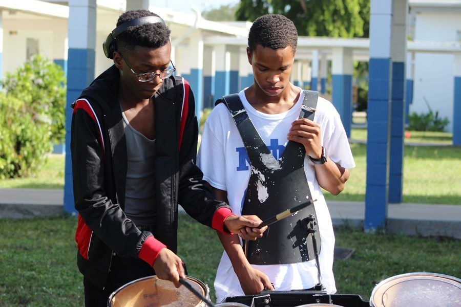 CATCH THE BEAT: Drumline members getting ready to perform at today's Open House, Aug. 22.