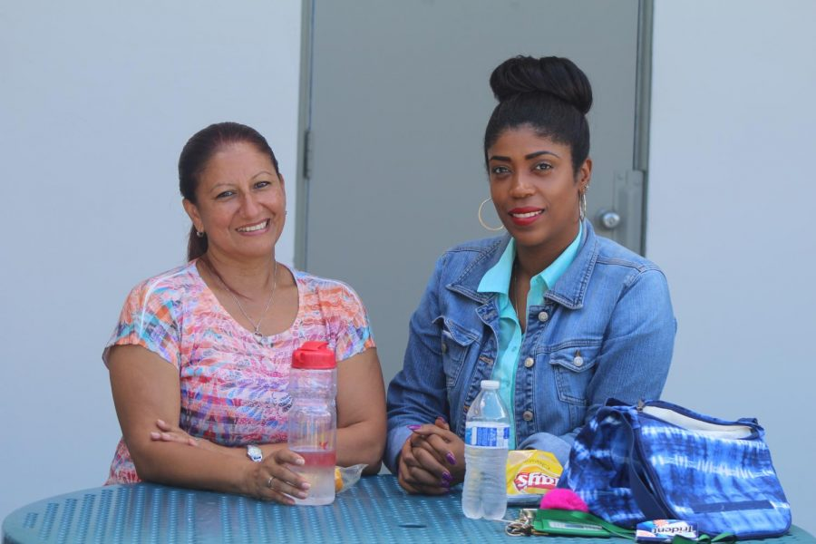 READY TO EAT: Administrative assistants Ms. Santos and Ms. Espinoza get together to enjoy their midday meal at their usual spot in the middle of the courtyard.