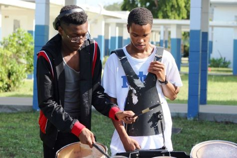 TO THE BEAT OF HIS OWN DRUM: Jouberson Joseph (Left) teaches Collin Lovelace a new cadence for their next parade.