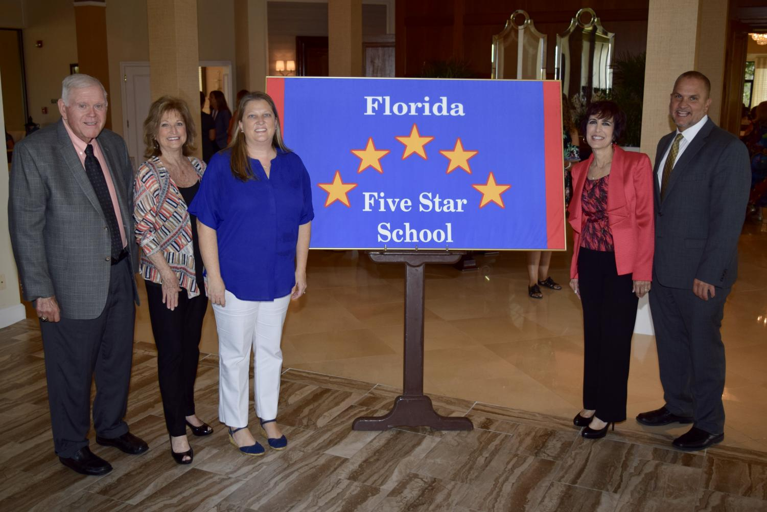JOB WELL DONE: Nurse Blair accepted deserved recognition from Palm Beach County School Board members Oct. 24 on behalf of the Inlet Grove team.