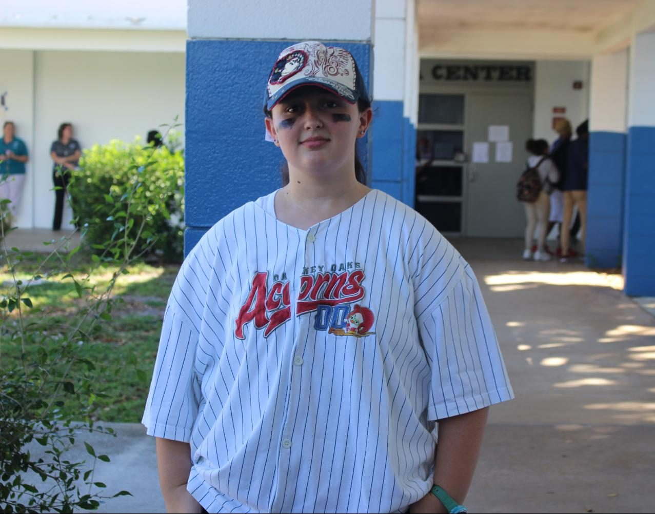 SPORTS GEAR DAY: Junior Dakota Sands celebrates the first day of Spirit Week by donning an Oakey Oaks Acorns baseball jersey from the 2005 Disney film